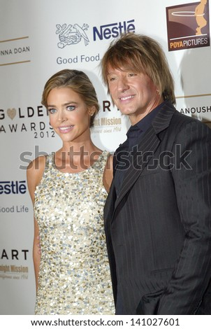BEVERLY HILLS - MAY 7: Denise Richards and Richie Sambora arrive at The 12th Annual Golden Hearts Awards on Monday, May 7, 2012 at the Beverly Wilshire Hotel in Beverly Hills, CA. - stock photo