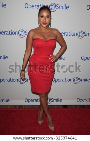 BEVERLY HILLS - OCT 2: Adrienne Bailon at the Operation Smile's 2015 Smile Gala  on October 2, 2015 at the Beverly Wilshire Four Seasons Hotel in Beverly Hills, CA. - stock photo