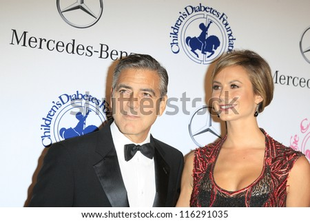 BEVERLY HILLS - OCT 20:  George Clooney, Stacy Keibler at the 26th Carousel Of Hope Ball at The Beverly Hilton Hotel on October 20, 2012 in Beverly Hills, California - stock photo