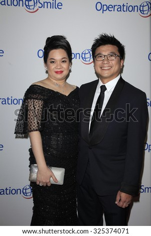 BEVERLY HILLS - OCT 2: Henry Nguyen, wife at the Operation Smile's 2015 Smile Gala  on October 2, 2015 at the Beverly Wilshire Four Seasons Hotel in Beverly Hills, CA. - stock photo