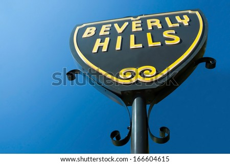 Beverly Hills sign in Los Angeles close-up view with beautiful blue sky in background - stock photo