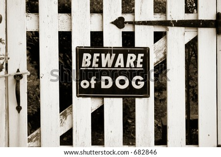 beware of dog sign on residential fence - stock photo