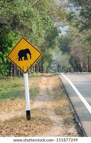 beware of elephants crossing the street in Erawan national park - Thailand - stock photo