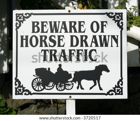 Beware of horse drawn traffic sign - stock photo