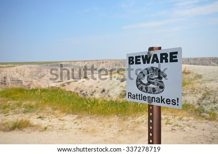 beware of rattlesnake sign in Badlands National Park, USA - stock photo