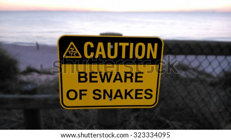 Beware of snakes sign on the beach in Australia