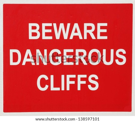 Beware of the dangerous cliffs sign. - stock photo