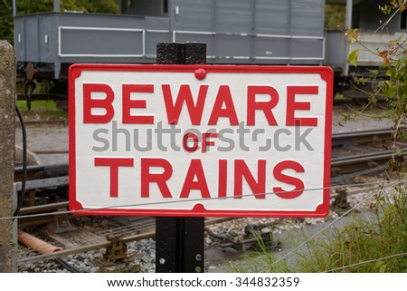 Beware of Trains sign at Railway Station