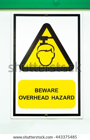 Beware overhead sign in condominium. - stock photo