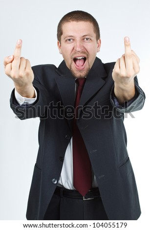 Bewildered businessman in suit and tie showing obscene sign with both hands - isolated on white - stock photo