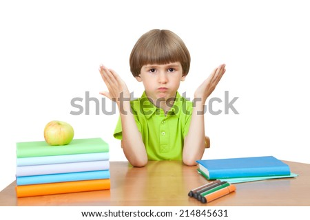 bewildered first-grader at the Desk - stock photo