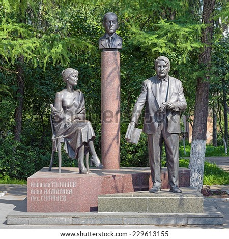 BEZHETSK, RUSSIA - JULY 24, 2014: Monument of Gumilyov Family with sculptures of Anna Akhmatova, Nikolay Gumilyov and Lev Gumilyov. The monument by Andrey Kovalchuk was unveiled on August 2, 2003. - stock photo