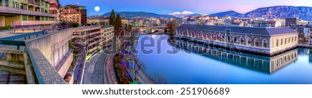 BFM, building and Rhone river by night with full moon, Geneva, Switzerland - stock photo