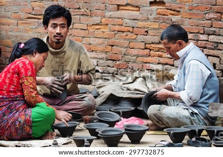 BHAKTAPUR, NEPAL - APR 5: Unidentified nepalese people working in the pottery workshop, Apr 5, 2014 in Bhaktapur, Nepal.   - stock photo