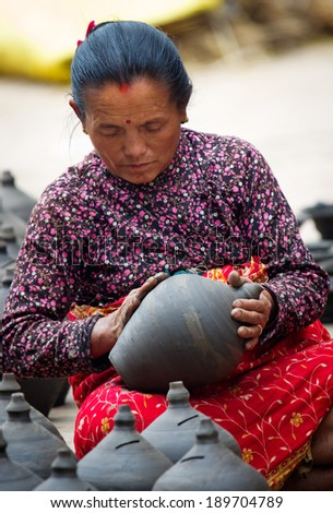 BHAKTAPUR, NEPAL - APR 5: Unidentified Nepalese woman working in the her pottery workshop, Apr 5, 2014 in Bhaktapur, Nepal.   - stock photo