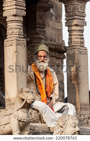 BHAKTAPUR, NEPAL APRIL 30 - An old sadhu sits in a temple in Bhaktapur, Nepal  on April 30th 2014