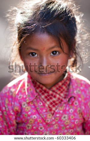 BHAKTAPUR, NEPAL - JANUARY 08: Portrait of nevaris girl Lakshmi, 7 on the street of old town on January 08, 2010 in Bhaktapur, Kathmandu Valley, Nepal.