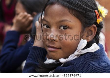 BHAKTAPUR, NEPAL - NOVEMBER 1, 2013: An undefined nepalese school girle portrayed in NEPAL - stock photo
