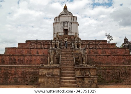 BHAKTAPUR, NEPAL - OCTOBER 19, 2013: The Fasidega temple in Bhaktapur is visited by thousands of Hindu pilgrims. The shrine is dedicated to Shiva and is protected byelephant, lion and cow statues - stock photo