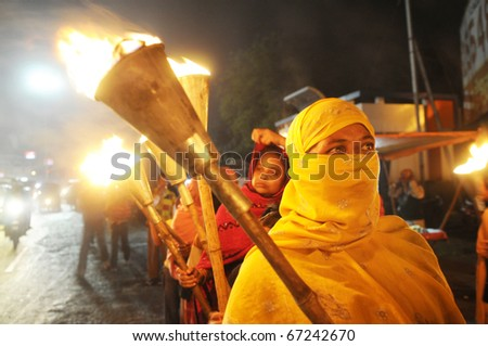 BHOPAL- DECEMBER 2: A Muslim activist during the torch rally organized to mark the 26th year of Bhopal gas disaster,in Bhopal - India on December 2, 2010. - stock photo