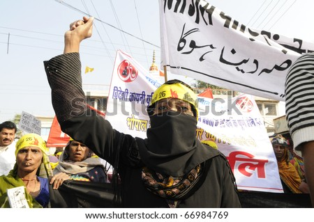 BHOPAL- DECEMBER 3: A Muslim woman wears burka and chanting slogans during the rally to mark the 26th year of the Bhopal Gas Disaster, in Bhopal - India on December 3, 2010.