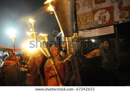 BHOPAL- DECEMBER 2: A part of the  torch rally, organized to pay homage to the victims of Bhopal gas disaster, in Bhopal - India on December 2, 2010. - stock photo