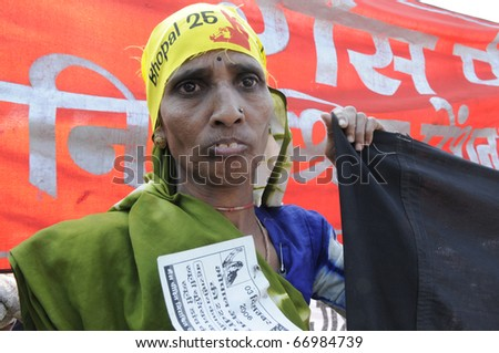 BHOPAL- DECEMBER 3: A victim holds banner during the rally to mark the 26th year of Bhopal Gas Disaster in Bhopal - India on December 3, 2010.