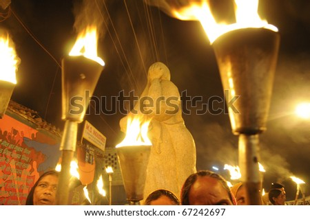 BHOPAL- DECEMBER 2: Activists  in front of the Bhopal Mother Statue  during the torch rally organized to mark the 26th year of Bhopal gas disaster, in Bhopal - India on December 2, 2010. - stock photo