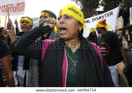 BHOPAL- DECEMBER 3: An angry Muslim woman chants slogans during the rally to mark the 26th year of Bhopal Gas Disaster  in Bhopal - India on December 3, 2010.