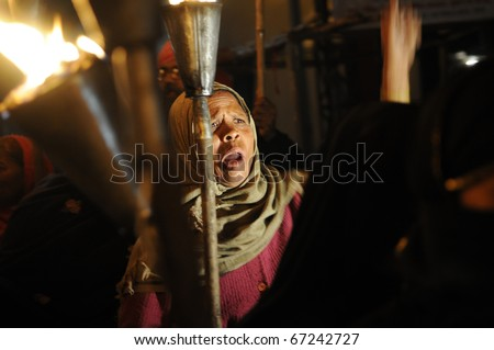 BHOPAL- DECEMBER 2: An angry protester during the torch rally organized to mark the 26th year of Bhopal gas disaster,in Bhopal - India on December 2, 2010. - stock photo