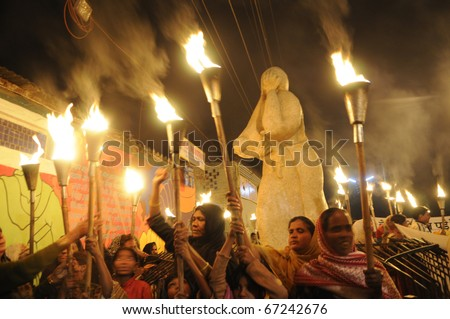 "BHOPAL- DECEMBER 2: Angry victims in front of the ""Bhopal Mother Statue""  during the torch rally organized to mark the 26th year of Bhopal gas disaster, in Bhopal - India on December 2, 2010. - stock photo"