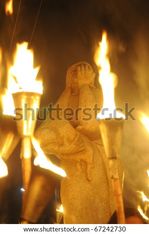 BHOPAL-DECEMBER 2:Bhopal Mother Statue- which shows a mother carrying her child running to escape the gas and the older girl child hanging on during the torch rally in Bhopal -India on December 2,2010 - stock photo