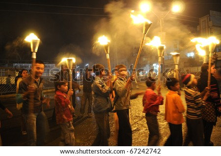 BHOPAL- DECEMBER 2: Children of Bhopal victims carry the torches during the torch rally to mark the 26th year of Bhopal Gas disaster,  in Bhopal - India on December 2, 2010. - stock photo