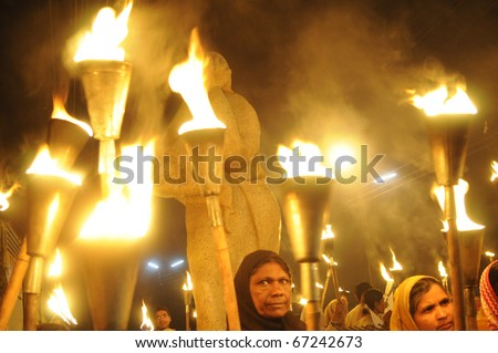 BHOPAL- DECEMBER 2: Clutter of lighted torches  during the torch rally organized to mark the 26th year of Bhopal gas disaster, in Bhopal - India on December 2, 2010. - stock photo