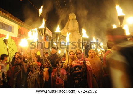 BHOPAL-DECEMBER 2: Protesters gather after the march near the Union Carbide plant during the torch rally organized to mark the 26th year of Bhopal gas disaster, in Bhopal -India on December 2,2010. - stock photo