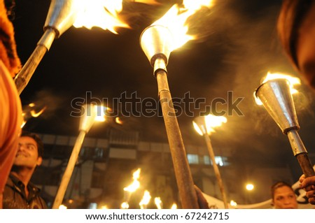 BHOPAL- DECEMBER 2: Protesters hold up their torches during the torch rally organized to mark the 26th year of Bhopal gas disaster, in Bhopal - India on December 2, 2010. - stock photo