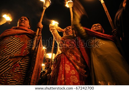 BHOPAL- DECEMBER 2: Rashida Bi( L) along with fellow activists  during the torch rally organized to mark the 26th year of Bhopal gas disaster in Bhopal - India on December 2, 2010. - stock photo