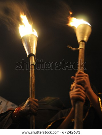 BHOPAL- DECEMBER 2: Strong hands of woman of Bhopal  during the torch rally organized to mark the 26th year of Bhopal gas disaster in Bhopal - India on December 2, 2010.