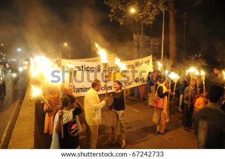 "BHOPAL- DECEMBER 2: The Mashaal rally on its way to the ""Bhopal Mother Statue"" during the torch rally to mark the 26th year of Bhopal Gas disaster, in Bhopal - India on December 2, 2010. - stock photo"