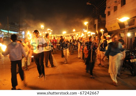 BHOPAL- DECEMBER 2: The rally on it's way  during the torch rally organized to mark the 26th year of Bhopal gas disaster, in Bhopal - India on December 2, 2010. - stock photo