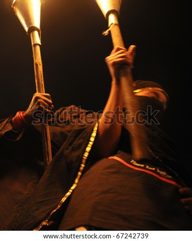 BHOPAL- DECEMBER 2: Two Muslim woman  hold torches during the torch rally to mark the 26th year of Bhopal Gas disaster, in Bhopal - India on December 2, 2010. - stock photo