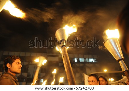 BHOPAL- DECEMBER 2: Victims hold their torches  during the torch rally organized to mark the 26th year of Bhopal gas disaster, in Bhopal - India on December 2, 2010. - stock photo