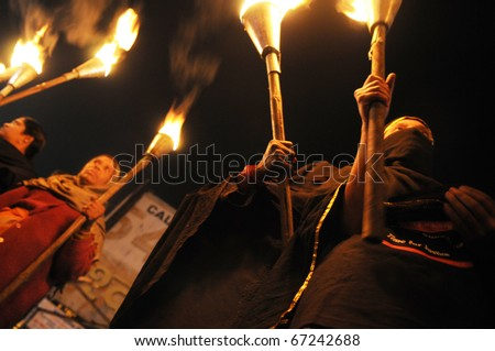 BHOPAL- DECEMBER 2: Victims of Bhopal hold torches  during the torch rally organized to mark the 26th year of Bhopal gas disaster, in Bhopal - India on December 2, 2010. - stock photo
