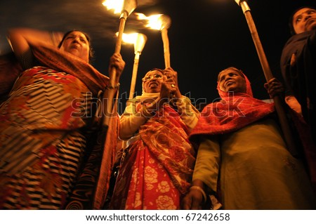 "BHOPAL- DECEMBER 2:  ""Woman of Bhopal"" during the torch rally organized to mark the 26th year of Bhopal gas disaster, in Bhopal - India on December 2, 2010. - stock photo"
