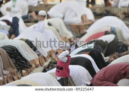 BHOPAL - NOVEMBER 16: unidentified Kids participating in the prayer along with their parents marking the end of Ramadan at Taj-ul-Masajid  on October 16, 2011 in Bhopal, India. - stock photo