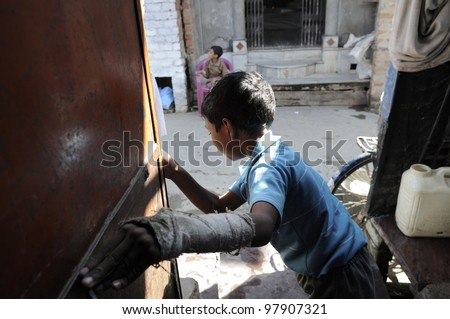 BHOPAL- NOVEMBER 21:  10 years old Aman reaching out for his brother Vikas on the other side of the road .Both brothers suffers from cerebral palsy from birth in Bhopal - India on November 21, 2010. - stock photo