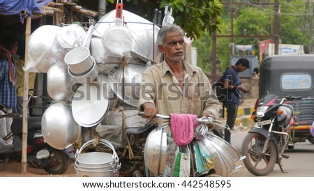 BHUBANESWAR, INDIA - 27 MAY, 2016: A busy traffic street in Bhubaneswar, Odisha. Bhubaneswar is a Capital of Odisha state in India. - stock photo