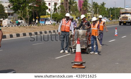 BHUBANESWAR, INDIA - 17 MAY, 2016: An unidentified Indian workers making street signs with machine.