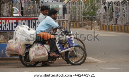BHUBANESWAR, INDIA - 27 MAY, 2016: An unidentified poor indian stopped at traffic signal at busy traffic street in Bhubaneswar, Odisha. Bhubaneswar is a Capital of Odisha state in India. - stock photo