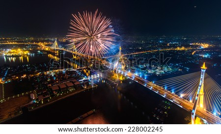Bhumibol Bridge and Bangkok City view with Colorful Fireworks, Thailand - stock photo